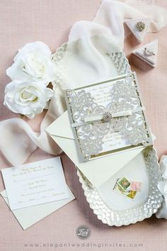Silver glitter laser cut wrap with champagne mirror paper bottom and buckle EWWS239