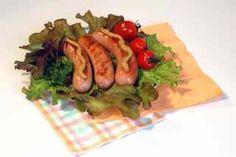 Cooked franks on lettuce