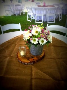 Southern Wedding With Daisies Wax flower in a metal tin with a tiny Mason Jar for a votive www.flowersfromus.net