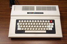 Our first computer was the TRS-80.  It connected to the TV and we used a tape recorder to save files.  Our favorite game was Mega Bug.