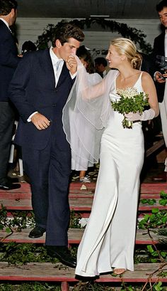 Carolyn Bessette-Kennedy wearing a Narciso Rodriguez wedding gown.