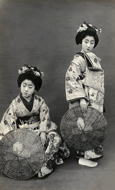 Geiko Tokiko (on the right) in costume for the Miyako Odori (Cherry Dance), [about 1920's, Japan]. Tokiko first appeared in the 1917 Miyako Odori programme as a maiko (apprentice geisha) and last appeared in the 1926 programme as a geiko (geisha). By 1928 a new maiko appeared under the name Tokiko.  Image and text via Blue Ruin 1 on Flickr