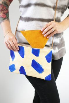 How cute is this tiny triangle coin pouch?! It's great for stashing in your tote, but don't be afraid of letting it shine all on its own. Triangle Coin Pouch, $42.
