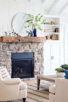 Home Remodeling Living Room Em - like the white built in cabinets on the bottom and small amt of open shelving above - navy and french blue pillows. White planked lake house living room with blue and white decor. Stone fireplace with rustic beam mantel. Home Fireplace, Modern Fireplace, Living Room With Fireplace, Fireplace Design, Fireplace Stone, Above Fireplace Ideas, Beach Fireplace, Sandstone Fireplace, Country Fireplace