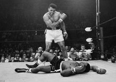Historic Photograph- Ali standing over Sonny Liston May 25, 1965