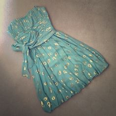 BCBG Strapless Green & Gold Dress Size 4 Beautiful BCBG strapless dress in a gorgeous seafoam color with gold metallic circle detailing, size 4. Excellent condition, worn once. BCBGMaxAzria Dresses Strapless