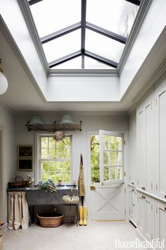 A skylight gives this mudroom the air of a conservatory.