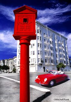 Buildings And Old Red Fire Box In Alamo Square, San Francisco By Mitchell Funk   mitchellfunk.com