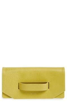 Matt & Nat 'Abiko' Vegan Leather Clutch at Nordstrom.com. A chic faux-leather clutch features a sleek front handle for street-savvy carrying, while an array of interior pockets provides organizational ease. Lining made from recycled plastic bottles adds an eco-friendly touch.
