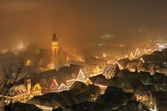 Lights in the fog by Robin Holler. Town from above - at a misty christmas evening. Germany, 2005