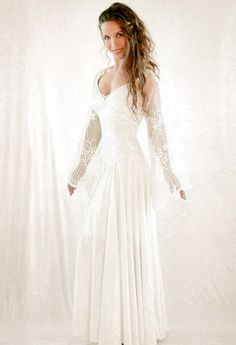 FWD: Lady Elaine is a classical medieval gown with a simple, elegant look. It is delicately decorated by braids which end in a Celtic knot at the waist. These and the other lines of the dress emphasize the graceful flow of the feminine body. Its beautiful ethereal sleeves are made out of finely embroidered and hand beaded lace.