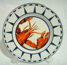 """Golden Rabbit Enamelware Red Lobster Dinner Plate by Golden Rabbit. $12.99. Not intended for microwave use. Stainless steel rim for greater durabilty. Dinner Plate measures 10.5"""" in diameter. Made from high quality carbon steel coated with porcelain enamel and finished with a stainless steel rim. Durable enough to use every day! Manufactured in Indonesia, FDA lead & cadmium tests are conducted by independent US labs. Enamelware is not intended for microwave use. Ov..."""