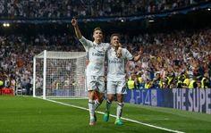 Real Madrid's Cristiano Ronaldo celebrates with Lucas Vazquez