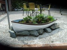 my mom just got an old row boat from a yard sale and I think this is a great idea for it in her huge yard!