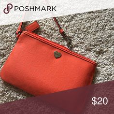Vibrant orange coach wristlet This is seriously so cute and perfect for summer! It's nice for when you don't want to take a whole purse. I've only used this a couple times so it looks brand new. Also selling a matching lanyard!! Coach Bags Clutches & Wristlets
