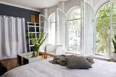 """The windows also present a big challenge, too: """"Being floor to ceiling and opening in, they take up a good portion of wall space limiting what you can do without blocking them or prohibiting their functionality!"""""""