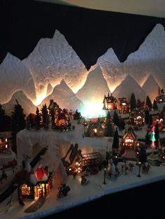 I love to stare at villages like this. Dept 56 North Pole Christmas Village lit up at night. Almost 100 buildings - this is a small section of my display. Christmas Village Lights, Christmas Town, Christmas Villages, Noel Christmas, Christmas Nativity, Christmas Crafts, Christmas Ornaments, Christmas Wreaths, Christmas Scenes