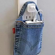 a #cellphoneholder mde from old jeans easy recharge no more worry about the charge cable hanging lose.  #countryliving  #jeans #diy-By SuperiorCustomLinens.com