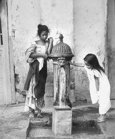 Filipino children at Paco's City hydrant, Manila, Philippines, early 1900
