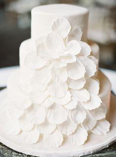 white wedding cake with floral detail | Photography: Marissa Lambert - www.marissalambertphotography.com