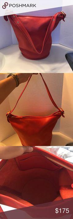 Authentic Coach Duffle Handbag Authentic Coach Duffle. Color Vermillion. In excellent condition.  Minor pen mark on side of handbag see picture. Size 8 x 13 x 8. Coach Bags Shoulder Bags