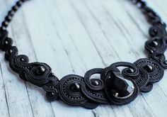 Soutache handmade embroidered necklace in black colors with agate beads and crystal. It fits ideal as cocktail dresses and clothes to the office.  FREE SHIPPING  As a talisman, agate is used to store the courage , calmness , self-confidence , promotes longevity .  Necklace made in technology soutache with crystal stone , beads agate, seed beads. The back side is sewn felt.  Lenght - 19 cm (7,48 inch) Width - 17 cm (6.69 inch) Height - 1 cm (0.39 inch) Weight - 39 g (1.72 oz)  Necklaces can…