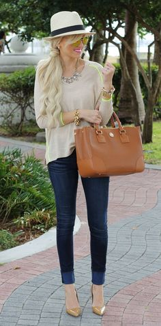 Gorheous off-white stylish blouse with brown leather cute hand bag and blue casual plan stylish jeans and golden yellow high heels ladies pumps and cute beach style cap & gorgeous necklace and braslate the perfect street style outfits