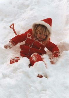 I love seeing a child, in the snow, wearing , a little red snowsuit!!!  All four pf my kids had a red snowsuit...