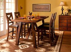 This Royce 5-piece counter-height dining set is where inspired mealtimes take shape! Its fine craftsmanship is evident in every detail—from its burnished mango veneers to its X-style stool backs. For easy cleanup, the stools' seats feature faux-leather coverings—you're going to love how very little upkeep they require!