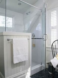 This is an interesting way to have a towel rack on the front of a glass shower. Like the privacy and open feel with glass top