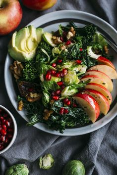 Apple, Kale and Brussels Sprouts Salad   Kale and sprouts topped with apples and pomegranate--perfect for the holidays!