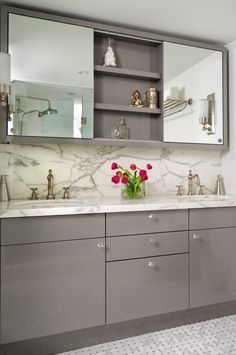 contemporary gray cabinets, marble countertop, custom medicine cabinet for storage above