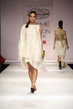 Indian Designer at Lakme Indian Fashion Week as part of Summer 2013. Follow Strand of Silk to get the best of Beautiful Indian Fashion from leading Fashion Designers, including Contemporary Indian Fashion and Indian Bridal clothes like Saris, Anarkalis, Salwar Suits, Lenghas, Indian Jewellery.