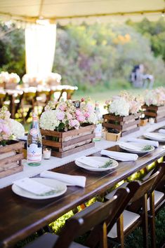 Rustic crate arrangements on long reception tables