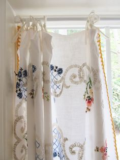 lovely vintage embroidered tablecloth as curtain, via dottie angel