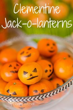 Simple healthy Halloween snack - draw jack-o-lanterns on clementine oranges