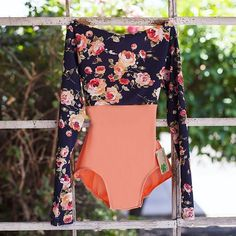 Floral print paired with soft salmon color in this full sleeve Luckyleo leotard, handmade in Arizona