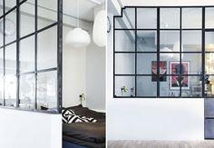 Sort vinduesvæg med jerntremmer mellem værelser