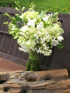 Blue Eryngium Thistles, Bud Stage Orchids, White Tulips, White Freesia, Green Roses, Green Viburnum, Other Florals & Foliage
