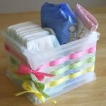 ribbon through holes in plastic bin makes a great gift basket! just fill with goodies!
