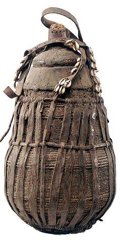 Africa | Ethiopian storage vessel | wood, fiber and cowrie shells