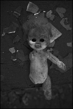 Dolls always freak me out, why are they abandoned & in such a state?.... Creepy