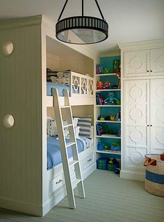 Fabulous built-ins in a children's room by Cullman & Kravis via Quintessence. Love the design on the doors mirrored on the bed railing. Fun AND sophisticated!