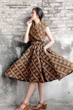 Batik Amarillis Made In Indonesia Batik Amarillis's Hey Day Wrap dress Our new classy & classic 50-ies dress inspired . Full skirt with large box pleats,shoulder wrap crosses bodice front and back zipper