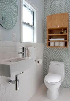 Living with tiny bathrooms is nothing new to small space dwellers. But living comfortably is all in the layout and fixtures. The right fixtures can make the difference of being able to squeeze in a powder room, or even transform a powder room into a full size bath. From sinks less than 8-inches deep to toilet-combination units, here are inspirational images of tiny sinks and real life fixtures to buy.