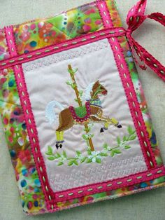 Carousel horse fabric book cover handmade bookcover by BookWraps. Bet you could have fun making your own too -enlist the kids to help pick out fabric! Horse Fabric, Fabric Book Covers, Make Your Own, Make It Yourself, Embroidered Quilts, Carousel Horses, Notebook Covers, Scrapbook Albums, Pretty In Pink