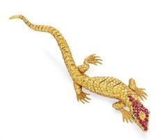 A COLORED DIAMOND, RUBY AND EMERALD SALAMANDER BROOCH, BY CARVIN FRENCH