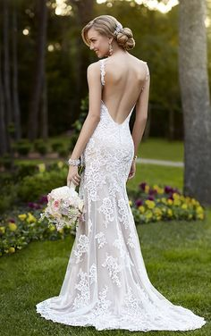 Lace over Lustre Satin V neck wedding dress expertly frames your face while hugging your curves to provide a perfect frame. Designer wedding dresses by Stella York.