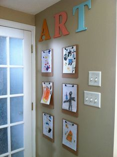 Kids art gallery wall: clipboards from the dollar store $6, letters from the craft store (40% off) $5.37, wall putty $1, leftover craft paint, total cost $12.37