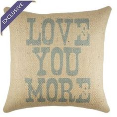 "Burlap pillow with a typographic motif. Handmade in the USA.  Product: PillowConstruction Material: Burlap coverColor: Blue and beigeFeatures:  Handmade by TheWatsonShopZipper enclosureMade in the USAInsert included Dimensions: 16"" x 16""Cleaning and Care: Spot clean"